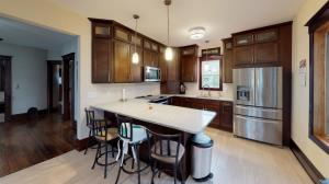 Quartz countertops, new cabinets, stainless steel appliances.
