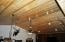 Pine vaulted ceilings in man cave/media room
