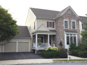 Several architectural features enhance this property, including a covered porch, glass front door, stone front, and boxed front windows. The community also has Belgium block curbing.