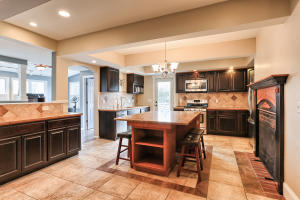 Fireplace, tile flooring, pull-out shelving, pantry