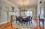 Formal Dining Room features a fireplace, columns, crown molding, hardwood floors re-purposed from Lancaster County Barns.