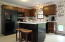 Kitchen features new countertops and island
