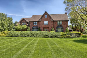 Definitely one of a kind...A must see captivating solid brick estate home on 1.7 gorgeous acres, perfect for your pool design. Boasts custom made handcrafted wood trim, doors, cabinetry & built ins. Formal LR plus FR on main. Inviting sun room. 2 brick WB FP's. Massive owners' suite w sitting room and 3 walk in closets. 2 rooms & storage in 3rd floor. LL boasts full bath, game room & exercise room. Fabulous 29x34 deck + gazebo. Amazing backyard setting. When the ordinary won't do...