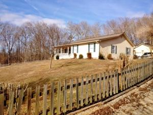 Situated atop a slight hilltop perches what you can call home - nearly 6 acres, barn, 2 car garage, sunroom, chicken coop, vineyard and fenced side yard.
