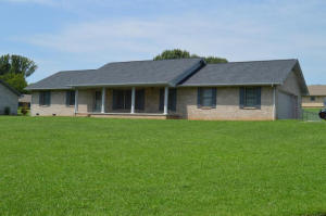 All Brick One-Owner Rancher on large level .67 Acre Lot with Fenced Backyard!