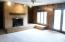 Family Room with Brick Wood Burning Fireplace & French Doors out to the Back Patio Area with Lake Views.