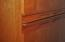 Notice the detail...handles for the cabinets are carved into the doors.