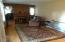 Large living room with beautiful gas log fire place/remote and hard wood floors