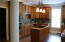 View of The Kitchen Area Revealing The Beautiful Custom Cabinetry Throughout.