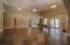 Beautiful Spacious Basement w/16' Ceilings, Ceiling Fans All Around, Concrete Stamped Flooring & French Doors Out To The Lower Patio.