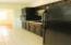 View 2 of kitchen - refrigerator stays