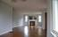 ...and fireplace. The hardwood extends into the hall and master bedroom