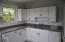 Kitchen with new quartz counter tops, refaced cabinets, new fixtures and paint.