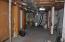 Unfinished shop/storage area on lower level