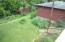 View from deck of backyard which is filled with perennials, ornamental grasses and shrubs