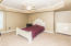 Huge bedroom 5 is located in the basement and has a trey ceiling and large closets
