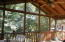 Relaxing screened porch just off den