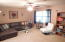 This wonderful 17x12 living room is adorned with fresh paint, neutral carpet & brand new ceiling fan!