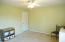 Main floor large guest bedroom measuring 11x11 with ample closet space!