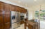 Kitchen with stainless steel appliances including higher end refrigerator. Cooktop installed 2015
