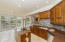 """Spacious kitchen with 42"""" Cabinets, granite counter tops, tiled back splash, stainless steel appliances and newly installed Travertine tile in 2015"""
