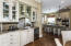 Wet Bar functions as Butlers Pantry and includes cabinets that are glassed on both sides