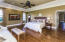 Master bedroom is located on main level with fine Italian Linen Drapery that convey with home.