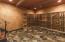 Real Flagstone and redwood wine racks compliment this versatile cellar room