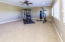This very large and versatile 19 x 16 room has so many optional uses, i.e. Bonus Room, Office, Exercise Room, Hobby/Crafts and boasts great natural lighting and overlooks the private yet scenic backyard.