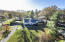 Perched on 1.25 Acres of land with mature landscaping