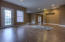 Large open basement Den with 9' ceilings and outside access.