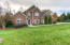Over 1 acre, beautifully sodded and landscaped.