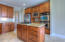 Warm custom cabinets and stainless appliances.