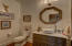 Main level half bath with custom vanity.