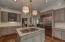 Beautiful grey cabinets and marble counter tops.