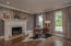 Formal living room/office with fireplace.