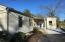 Easy access to back yard from enclosed pool area with new concrete pation