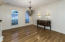 Dining Room has hardwood floor, crown molding & chandelier