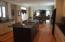Kitchen expansive cabinetry open to Entertainment wing!