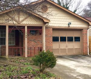Garage, covered porch, great location