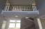Entry area-lots of natural light, wrought iron spindles on stairways and overlook.