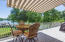 Enjoy the Trex back main level deck and awning