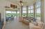 Great Room opening to deck; decorative trim around door; remote control shades