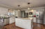 Kitchen with marble counter tops stainless steel appliances and gas range