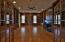 library has rich hardwood floors, gas log frplc, cherry walls & shelving
