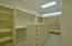wonderful master bdr closest with built in dresser & shelving