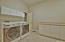 large laundry room with washer, dryer and freezer