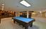 large rec room with built in cabinetry ,state of art,surround sound,pool table
