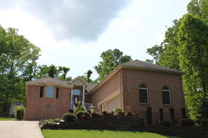 This all brick home sits at the top of the world! Privacy and golf course views are yours!