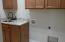 Laundry w/ granite & Tile